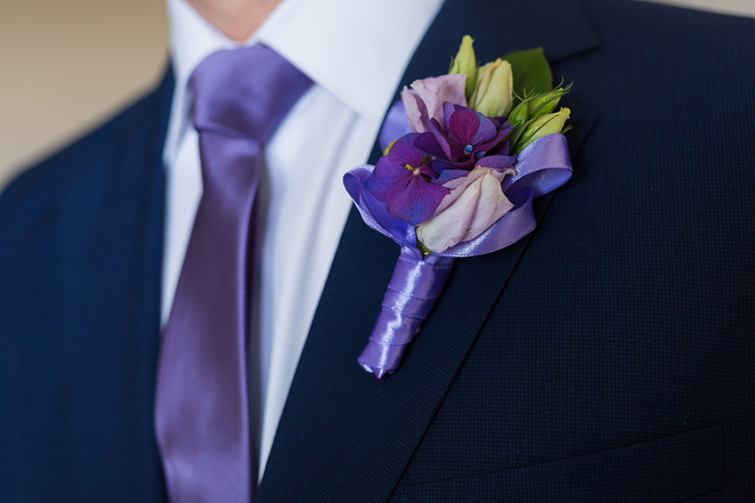 Violet tie and boutonniere