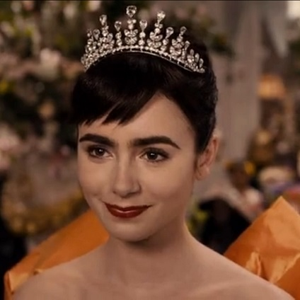 Lily Collins wearing a tiara in the movie Mirror Mirror