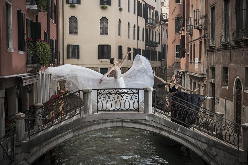 A bride-to-be and her friend dancing in Venice
